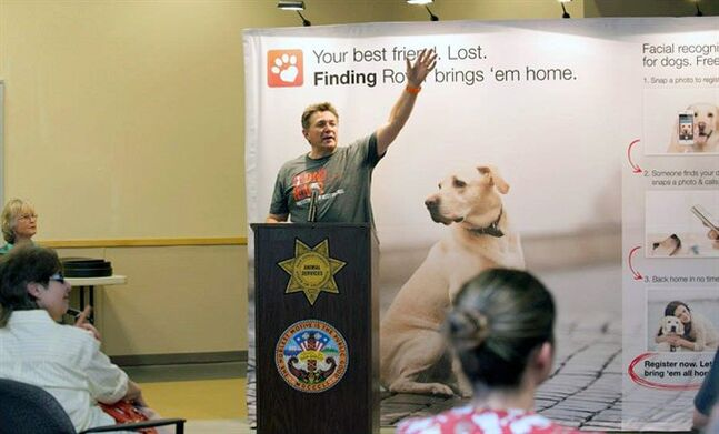 This May 16, 2014 photo provided by FindingRover.com shows founder of the smart phone application Finding Rover John Polimeno during a news conference in San Diego. In May, San Diego County Animal Services became the first shelter system in the country to adapt the facial recognition plan. Every dog entering the county's three shelters will be put in the database. (AP Photo/FindingRover.com)