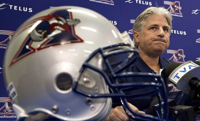 Montreal Alouettes general manager Jim Popp comments on the firing of head coach Dan Hawkins Thursday, August 1, 2013 in Montreal. The Alouettes are extending the contract of general manager Popp.THE CANADIAN PRESS/Paul Chiasson