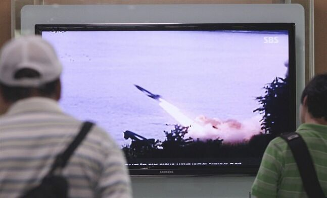People watch a TV news program showing the missile launch conducted by North Korea, at Seoul Railway Station in Seoul, South Korea, Sunday, June 29, 2014. North Korea fired two short-range missiles into its eastern waters Sunday, a South Korean official said, an apparent test fire that comes just days after the country tested what it called new precision-guided missiles. (AP Photo/Ahn Young-joon)