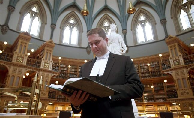 House Speaker Andrew Scheer leafs through parliamentary debates on May 27, 2014 in Ottawa. THE CANADIAN PRESS/Adrian Wyld