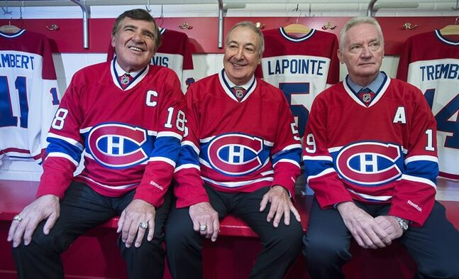 From left, Montreal Canadiens' Big 3 defencemen, Serge Savard, Guy Lapointe and Larry Robinson, pose for photos at the Canadiens' Hall of Fame in Montreal, Thursday, June 19, 2014. The team announced they were retiring Lapointe's number five jersey. THE CANADIAN PRESS/Graham Hughes