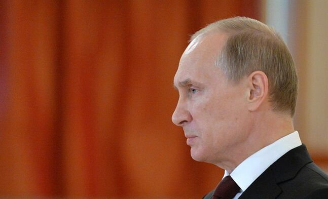 Russian President Vladimir Putin attends a ceremony of the presentation of credentials, in the Grand Kremlin Palace in Moscow, Friday, June 27, 2014. (AP Photo/Yuri Kadobnov, Pool)