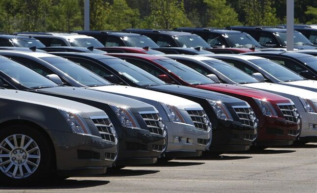 """File-This July 14, 2010, file photo shows Cadillac CTS vehicles being displayed outside the LaFountaine Cadillac in Highland Township, Mich. General Motors' safety crisis worsened on Monday, June 30, 2014, when the automaker added 8.2 million vehicles to its huge list of cars recalled over faulty ignition switches. The latest recalls cover seven vehicles, including the Chevrolet Malibu from 1997 to 2005 and the Pontiac Grand Prix from 2004 to 2008. The recalls also cover a newer model, the 2003-2014 Cadillac CTS. GM said the recalls are for """"unintended ignition key rotation."""" (AP Photo/Carlos Osorio, File)"""