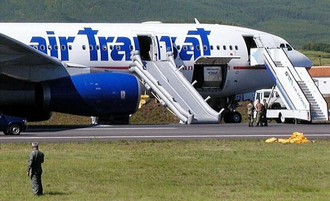 A Canadian Air Transat plane with its emergency slides deployed, sits on the tarmac of Lages airport in the Azores Terceira island, after an emergency landing, Friday, Aug, 24, 2001, in the north Atlantic Portuguese archipelago.Thirteen years ago next week marks what could have been a grim anniversary: Air Transat Flight 236, bound to Lisbon from Toronto, crash-landed on an island in the Azores off Portugal after running out of fuel over the Atlantic. (AP Photo/Humberta Augusto)