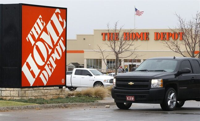 FILE - In a Nov. 14, 2011, file photo, a truck pulls out of the parking lot at a Home Depot store in Oklahoma City. Home Depot Inc. reports quarterly earnings on Tuesday, May 20, 2014. (AP Photo/Sue Ogrocki, File)