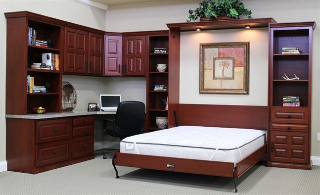 This photo provided by The Bedder Way Co., shows a Murphy bed that's ready for an overnight guest. Customers like that the beds are designed to accommodate standard mattresses, said company vice president Chris Fahy. (AP Photo/Courtesy of The Bedder Way Co.)