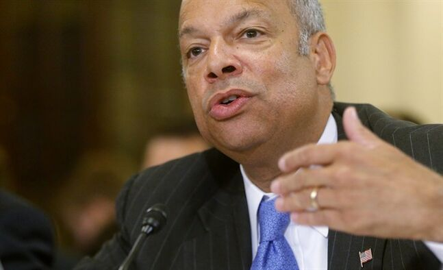 FILE - In this June 24, 2014, file photo, Homeland Security Secretary Jeh Johnson testifies on Capitol Hill in Washington. Johnson is ordering increased security measures at some overseas airports offering direct flights to the United States. The Homeland Security Department would not immediately say July 2 whether the increased measures were in response to intelligence about a specific threat. But a U.S. counterterrorism official says American intelligence has seen indications that certain terrorist groups in Yemen and Syria are working on a bomb that could make it through airport security undetected. (AP Photo/Charles Dharapak, File)