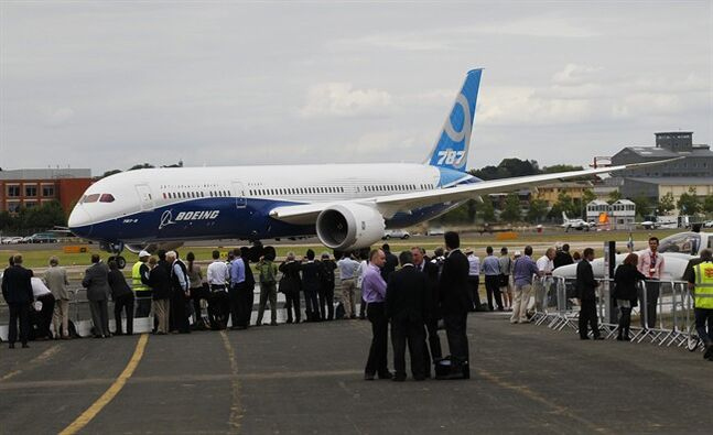 A Boeing 787 prepares to take off for a display during Farnborough International Air Show, Farnborough, England, Wednesday, July 16, 2014. (AP Photo/Sang Tan)