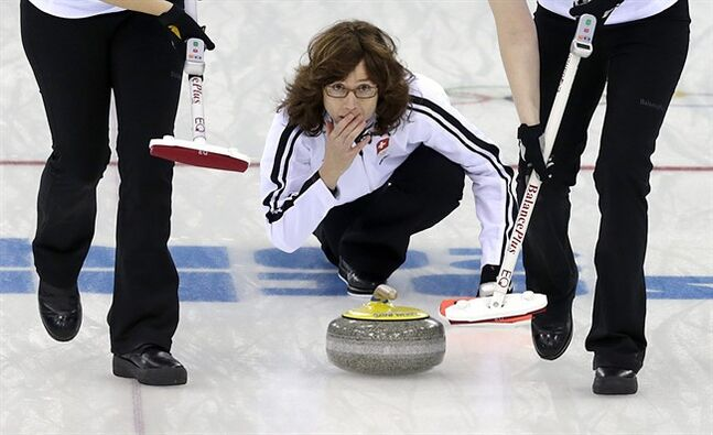 Switzerland's skip Mirjam Ott delivers the rock during the women's curling bronze medal game against Britain at the 2014 Winter Olympics, Thursday, Feb. 20, 2014, in Sochi, Russia. (AP Photo/Wong Maye-E)