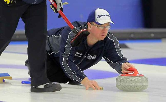 Neepawa's Jerry Chudley throws a stone during his competitive division final against Rui Liu at the Brandon Men's Bonspiel at the Brandon Curling Club on Sunday.