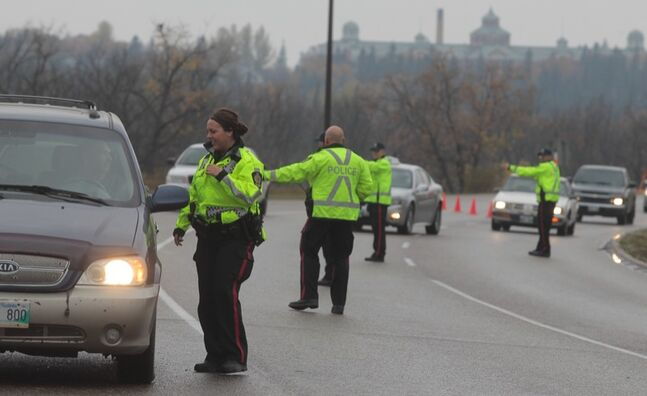 Members of the Brandon Police Service conduct s check-stop on First Street North in October. With an e-ticketing system like the ones already being tested in Alberta and Saskatchewan, local police will be able to swipe a driver's licence to download information and print a ticket instead of filling one out by hand.