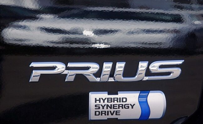In this March 16, 2008 photo, the logo on the side of a Toyota Prius hybrid car is seen in Springfield, Ill. THE CANADIAN PRESS/AP, Seth Perlman