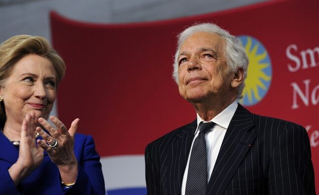 "Former Secretary of State Hillary Rodham Clinton applauds designer Ralph Lauren after Lauren received the James Smithson Bicentennial Medal ""for his embodiment of the American experience through the medium of fashion, design and philanthropy"