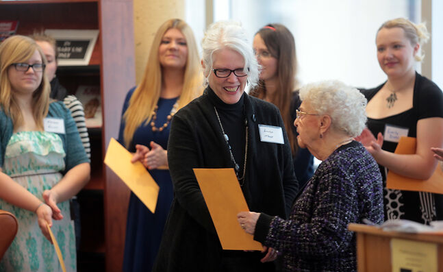 Brandon University student Linda Tame receives a certificate on Thursday from Bea Jolly, right, during BU's salute to outstanding female students in recognition of International Women's Day, which will be celebrated on Saturday.