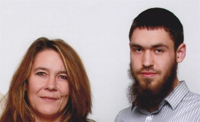 This undated family photo provided by Chris Boudreau shows Boudreau, left, and her son, Damian Clairmont. Clairmont, a Calgary, Canada native, was 22 when he was killed in fighting between rival groups of Islamic militants in the Syrian city of Aleppo. Boudreau feels abandoned by Canadian authorities, who she said failed to tell her they had been observing Damian before he left for Syria. (AP Photo/Boudreau Family)