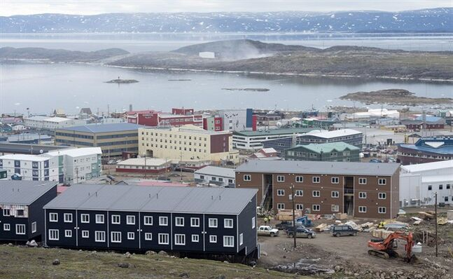 An overall view of Iqaluit, Nunavut is shown on Tuesday July 8, 2014. Iqaluit is a territorial capital in a G7 nation but its waterfront has scarcely changed since English explorer Martin Frobisher visited there in 1576. THE CANADIAN PRESS/Adrian Wyld