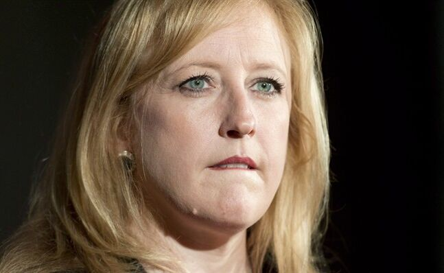 Transportation Minister Lisa Raitt addresses a news conference in Ottawa, Monday, May 26, 2014. Canada's information watchdog is taking the Toronto Port Authority to court for refusing to disclose an audited expense report from a time when Raitt was at the agency's helm.THE CANADIAN PRESS/Adrian Wyld