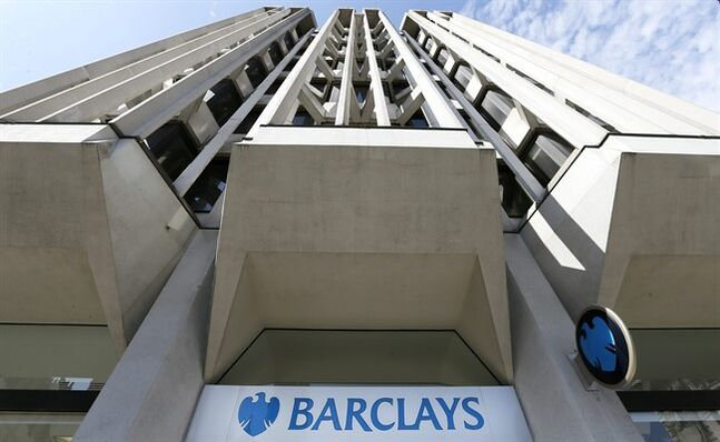 FILE - This Wednesday April 24, 2013 file photo shows a branch of Barclays Bank in London. Barclays, Britain's second-biggest bank in terms of assets, is to slash up to 12,000 jobs as it seeks to change its corporate culture following a string of scandals. But even as the reductions were announced Tuesday Feb. 11, 2014, Barclays set aside more money for bonuses. The bonus pool rose by 210 million pounds in 2013 — a move Chief Executive Antony Jenkins defended despite the fact the bank's performance worsened in the fourth quarter. (AP Photo/Kirsty Wigglesworth, File)