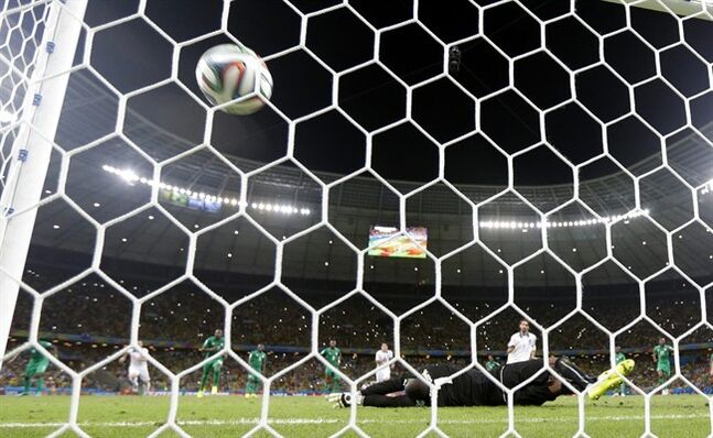 Greece's Giorgos Samaras, right, scores his side's second goal from the penalty spot during the group C World Cup soccer match between Greece and Ivory Coast at the Arena Castelao in Fortaleza, Brazil, Tuesday, June 24, 2014. (AP Photo/Fernando Llano)