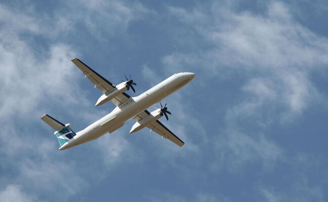 The first WestJet Encore flight makes a pass over the Brandon airport last year. WestJet inaugurated a Brandon–Calgary service in September 2013.