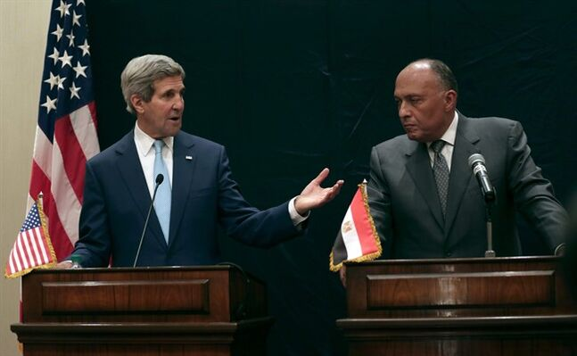 U.S. Secretary of State John Kerry, left, speaks during a joint news conference with Egyptian Foreign Minister Sameh Shoukry following his meeting with Egyptian President Abdel-Fattah el-Sissi, Sunday, June 22, 2014, in Cairo, Egypt. (AP Photo/Maya Alleruzzo)