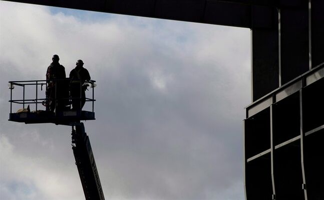 Workers are pictured at the Vancouver Shipyard Oct. 7, 2013. THE CANADIAN PRESS/Jonathan Hayward