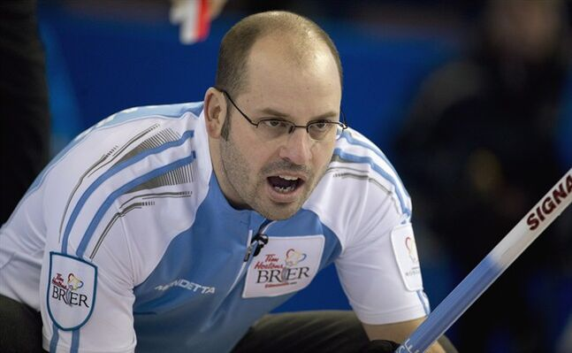 Quebec skip Jean-Michel Menard calls a shot during the afternoon draw against Manitoba at the Tim Hortons Brier in Edmonton, Alta. Monday, March 4, 2013. THE CANADIAN PRESS/Jonathan Hayward