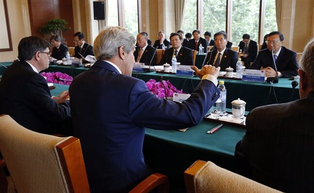 U.S. Secretary of State John Kerry, center, and Treasury Secretary Jack Lew, left, participate in a joint session on Climate Change and Clean Energy with China's Minister of Finance Lou Jiwei, third right, China's Vice Premier Wang Yang, second right, and State Councilor Yang Jiechi, right, at the Diaoyutai State Guesthouse in Beijing,China Wednesday, July 9, 2014. (AP Photo/Jim Bourg, Pool)