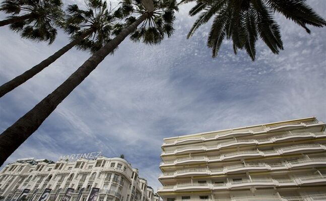 In this photo taken on Monday, May 12, 2014, the Martinez Hotel on the Croisette in Cannes, southern France. The Martinez is currently home to dozens of brands such as Pucci, Armani, Valentino and Bulgari, all installed in real suites only for the length of the Cannes film festival. (AP Photo/Virginia Mayo)