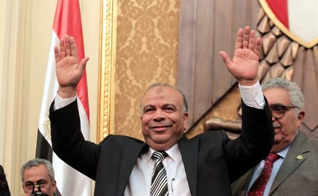 FILE - In this Monday, Jan. 23, 2012 file photo, Saad el-Katatni, Egypt's then newly-elected parliament speaker gestures during the first session after the revolution that ousted former President Hosni Mubarak, in Cairo, Egypt. Egypt's highest administrative court dissolved Saturday, Aug. 9, 2014, the Freedom and Justice Party, the political party of the banned Muslim Brotherhood, and ordered its assets liquidated, in the latest move against the 86-year-old Islamist group. El-Katatni led the party after Morsi became the country's first freely elected president in 2012. He also served as speaker of the parliament, dominated by his party. The parliament was dissolved after Morsi's ouster. (AP Photo/Khaled Elfiqi, Pool, File)