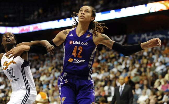 FILE - In this June 29, 2013 file photo, Connecticut Sun's Kalana Greene, left, and Phoenix Mercury's Brittney Griner eye a rebound during the first half of a WNBA basketball game in Uncasville, Conn.�The WNBA is launching a campaign to market specifically to the gay, lesbian, bisexual and transgendered community. It's the first league to design such a campaign. Griner, who is one of a handful of WNBA athletes who have publicly identified themselves as lesbian, was happy the league was embracing the community. (AP Photo/Jessica Hill, File)