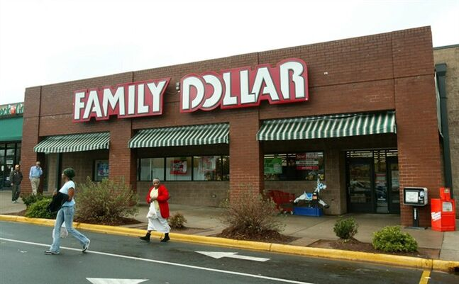 Customers walk past a Family Dollar store at Hickory Grove Market in Charlotte, N.C. on Nov. 29, 2005. THE CANADIAN PRESS/AP, Ross Taylor