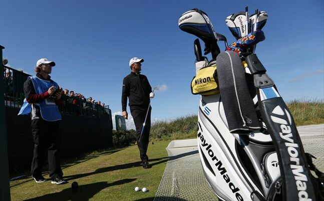 Robert Karlsson of Sweden prepares to play off the 13th tee during a practice round ahead of the British Open Golf championship at the Royal Liverpool golf club, Hoylake, England, Tuesday July 15, 2014. The British Open starts on Thursday July 17. (AP Photo/Jon Super)
