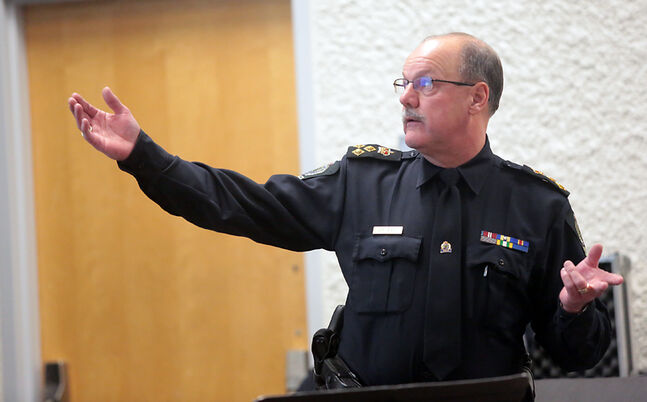 Brandon Police Service Chief Ian Grant makes a presentation during a Brandon Police Board public forum at Crocus Plains high school on Tuesday evening.