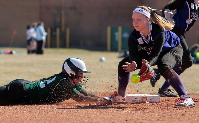 Neelin's Courtney Matienzo slides back to second ahead of the throw to Vincent Massey's Megan Asham Tuesday.