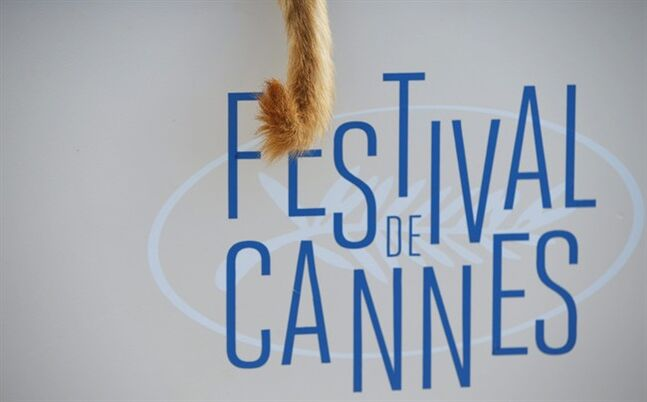 In this Saturday, May 17, 2014 file photo, the tail of a dog hangs off the edge of a table during a photo call for White God (Feher Isten) at the 67th international film festival, Cannes, southern France, Saturday, May 17, 2014. Proving that it's a dog eat dog world, four-legged performances have stolen the show in a number of films screened at the festival from top directors including Jean-Luc Godard and David Cronenberg. And there's no clear front runner. (AP Photo/Alastair Grant)