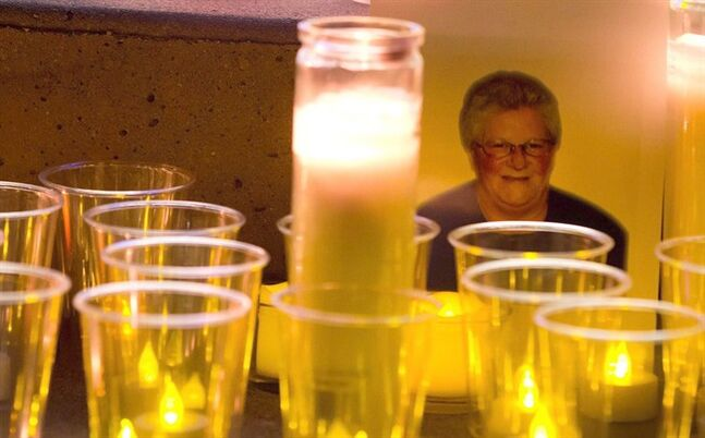 A photo of Julie Paskall is surrounded by candles during a vigil in Surrey, B.C., on January 18, 2014. THE CANADIAN PRESS/Darryl Dyck