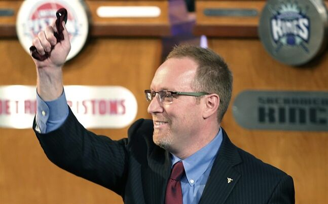 Cleveland Cavaliers general manager David Griffin holds a lucky bow tie after the Cavaliers won the first pick in the NBA draft lottery, in New York on Tuesday, May 20, 2014. The bowtie was worn by Nick Gilbert, son of Cavaliers owner Dan Gilbert, who represented the Cavs in the previous draft lottery, when they also won the first pick. It's the third time in four years the Cavs will be atop the draft after moving up from the ninth spot. (AP Photo/Kathy Willens)