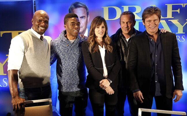 Actors Terry Crews, from left, Chadwick Boseman, Jennifer Garner, Kevin Costner and Denis Leary pose for a photograph at a news conference for the movie