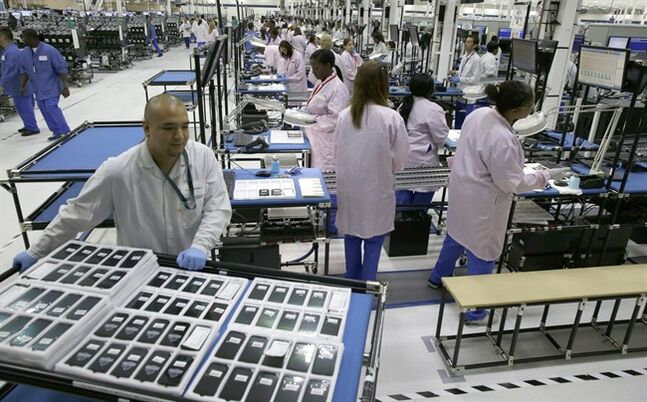 FILE - In this Tuesday, Sept. 10, 2013, file photo, workers man the Motorola smartphone plant in Fort Worth, Texas. Cellphone pioneer Motorola has announced it's closing a Texas manufacturing facility just a year after announcing its opening. (AP Photo/LM Otero, File)