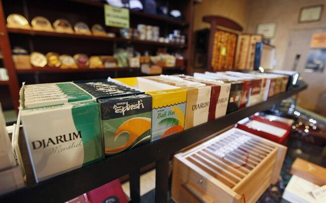 Flavoured cigarettes are shown on display at a tobacco store in Richmond, Va. in a file photo. A new study finds that among Canadian teens who use tobacco, more than half are opting for flavoured products. THE CANADIAN PRESS/AP, Steve Helber