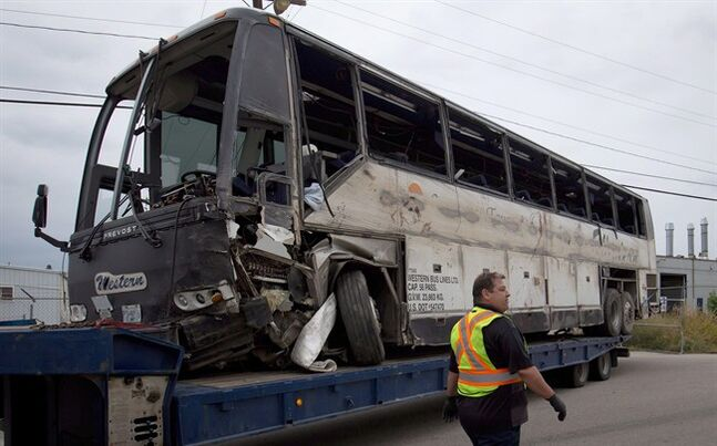 The tour bus that rolled over and crashed on the Coquihalla Highway south of Merritt, B.C., is pictured in Kelowna, on Friday August 29, 2014.THE CANADIAN PRESS/Darryl Dyck