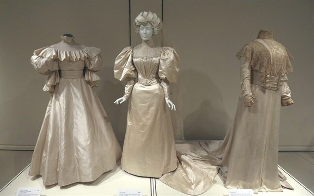 In this photo taken on Tuesday, July 1, 2014, * Wedding dresses made in from left, 1982, 1894, 1905 are displayed display during the