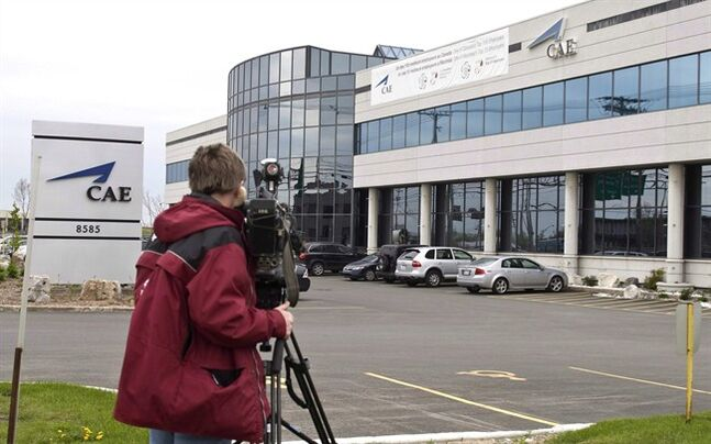 A television cameraman shoots footage of the CAE headquarters in Montreal on May 14, 2009. THE CANADIAN PRESS/Paul Chiasson