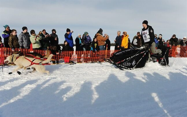 Dallas Seavey leaves the starting line of the Iditarod Trail Sled Dog Race, Sunday, March 3, 2013, in Willow, Alaska. 65 teams will be making their way through punishing wilderness toward the finish line in Nome on Alaska's western coast 1,000 miles away. (AP Photo/The Anchorage Daily News, Bob Hallinen) LOCAL TV OUT (KTUU-TV, KTVA-TV) LOCAL PRINT OUT (THE ANCHORAGE PRESS, THE ALASKA DISPATCH)