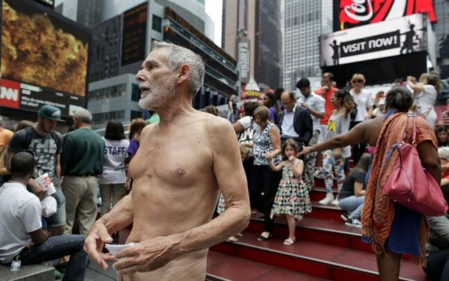George Davis, a candidate for the San Francisco Board of Supervisors, makes a speech in the nude on Times Square, Wednesday, Aug. 6, 2014, in New York. Davis spoke out against a 2013 San Francisco public nudity ban that was introduced by his opponent, Scott Wiener, saying nudity is a freedom of expression. (AP Photo/Julie Jacobson)