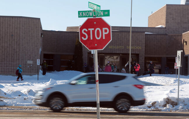 Traffic passes through the crosswalk area on Knowlton Drive at Kirkcaldy Heights School, where two students were struck by a vehicle on Feb. 18. The students were not hurt.