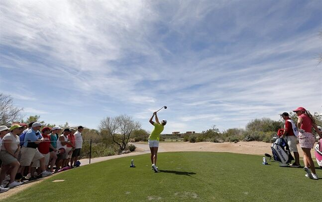 Stacy Lewis hits from the 18th tee during the second round of the LPGA Founders Cup golf tournament, Friday, March 15, 2013, in Phoenix. (AP Photo/Matt York)