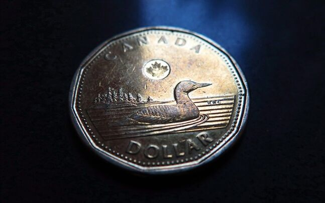 A Canadian dollar or loonie is pictured in North Vancouver, B.C. Wednesday, March 5, 2014. THE CANADIAN PRESS/Jonathan Hayward