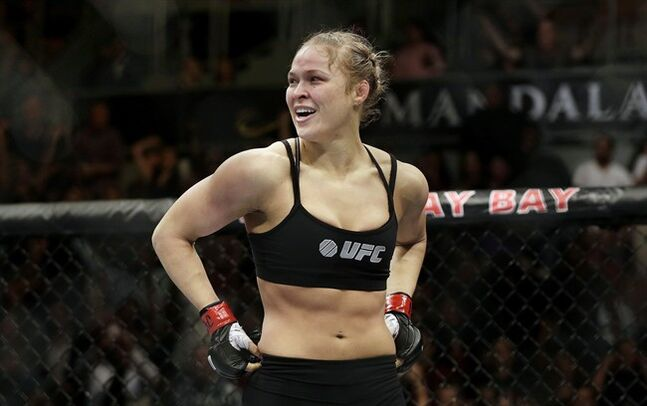 Ronda Rousey looks around after defeating Sara McMann in a UFC 170 mixed martial arts women's bantamweight title bout in Las Vegas on Feb. 22, 2014. Perhaps no one is happier that the UFC is introducing a 115-pound strawweight division for women than bantamweight champion (Rowdy) Ronda Rousey. THE CANADIAN PRESS/AP, Isaac Brekken